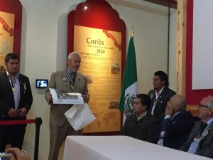 Ian Doble, Trustee and Chair Elect of the Royal Institution of Cornwall (RIC), presenting a photograph from the collection of the RIC to the Museo del Paste, Real del Monte, Mexico