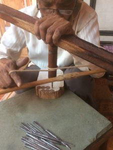 Wood block carving with hand drill, Pethapur
