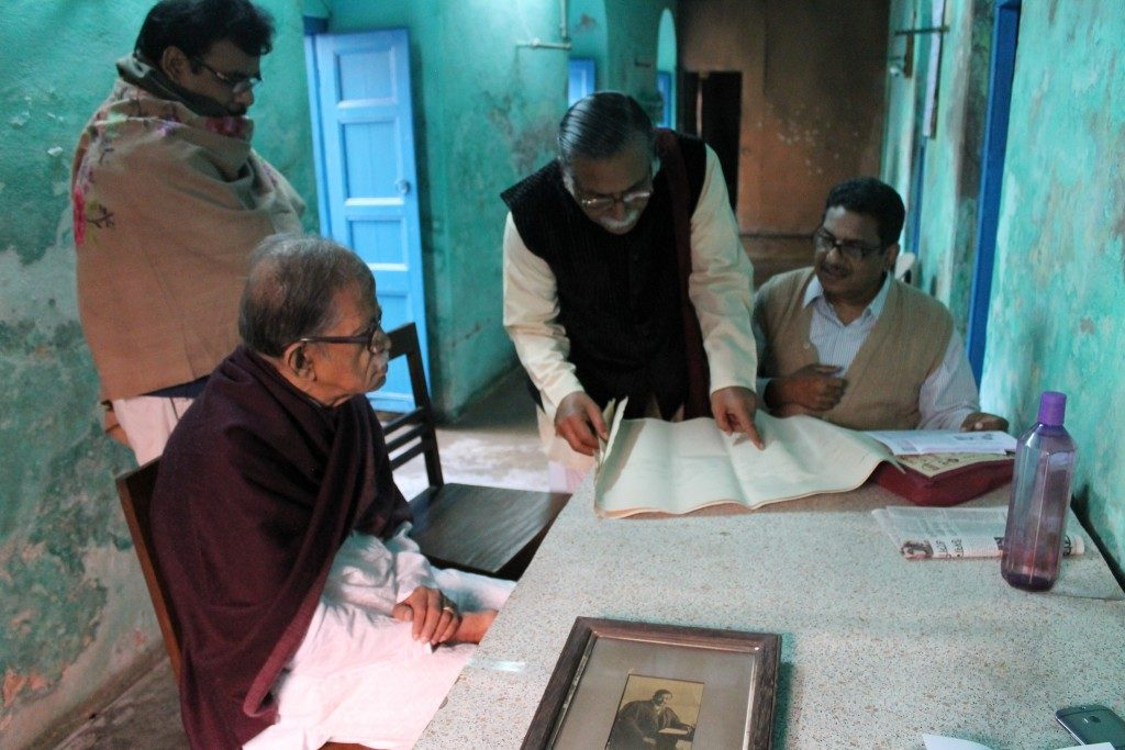 Local historians in Chandannagar, discussing the Sen family tree at the birthplace of Jogendra Nath Sen ©Leeds Museums & Galleries, photographed by Lucy Moore