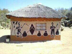 Rural home painted using natural soil pigments. Art works often depict flora, fauna and rural chores.
