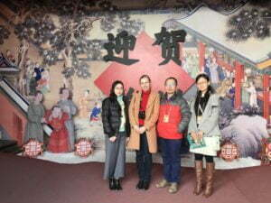 Zhang Linjie, his colleagues from the Palace Museum, Beijing and I at the entrance to the exhibition 'Celebrating the Spring Festival in the Forbidden City'.