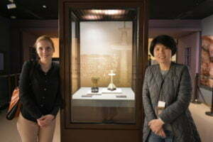 Yili Hou and I standing next to the 'Gold Cup of Eternal Stability' at the National Palace Museum, Taipei.