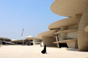 Doha / Qatar – September 30, 2019: A local woman walks through the main courtyard of the National Museum of Qatar (Photo: Dominic Dudley)
